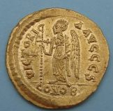 London Coins : A122 : Lot 1131 : Anastasius (AD491-518) gold Solidus. Helmeted and cuirassed bust facing holding spear and shield. R....