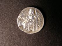London Coins : A122 : Lot 1132 : Ancient Greece Drachm Philip III (336-323BC) Kolophon Mint, Obverse head of Herekles right, ...