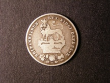 London Coins : A126 : Lot 1403 : Shilling 1825 Lion on Crown ESC 1254A with Roman 1 in date Rated R7 by ESC VG