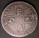 London Coins : A142 : Lot 2311 : Halfcrown 1696E First Bust, Large Shields, Early Harp ESC 526 VG with some old scratches,...