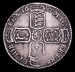 London Coins : A153 : Lot 2928 : Halfcrown 1697 First Bust Large Shields, with I over E in GVLIELMVS a very clear overstrike, Fine wi...