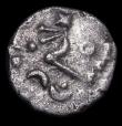 London Coins : A157 : Lot 1720 : Celtic.  Dobunni.  Ar unit.  C, 30-15 BC.  Obv; Celticized head right, star on chin.  Rev; Horse lef...