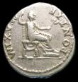 London Coins : A157 : Lot 1829 : Titus.  Ar denarius.  C, 73 AD.  Rev; PONTIF MAXIM; Vespasian std r on curule chair hldg sceptre.  R...