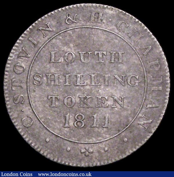 Shilling 19th Century Lincolnshire - Louth 1811 C.Stovin/H.Chapman Reverse: a fleece suspended Davis 15 NEF, lists at £380 EF in Withers, we note that our archive database stretching back to 2003 shows that we have not previously offered an example  : Tokens : Auction 161 : Lot 938