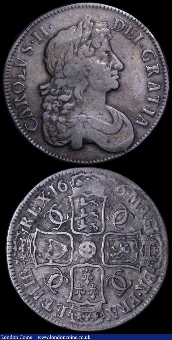 Crowns (2) 1662 No Rose below bust, No edge date ESC 19, Bull 347 VG, 1676 ESC 51, Bull 397 About Fine/Fine with some surface residue from vinyl storage, this possibly removable with care : English Coins : Auction 162 : Lot 1742