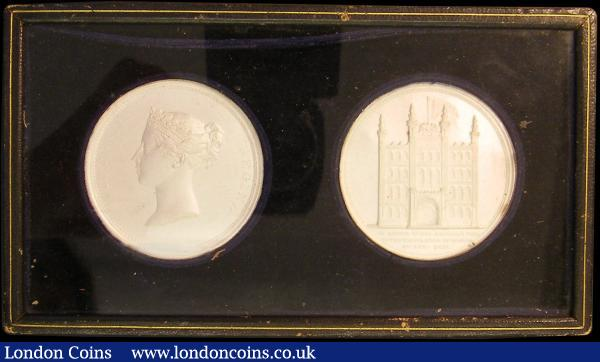 Visit of Queen Victoria to the City of London 1837, issued by the Corporation of London obverse and reverse cliché in a glass frame, presumed silver, sealed with a note Obverse VICTORIA REGINA, bust left diademed, Reverse a Façade of the Guildhall, Exergue: IN HONOUR OF HER MAJESTY'S VISIT TO THE CORPORATION OF LONDON 9TH NOV : 1837, UNC the colour considered to be the result of silver oxidising reacting to the glass. : Medals : Auction 162 : Lot 933