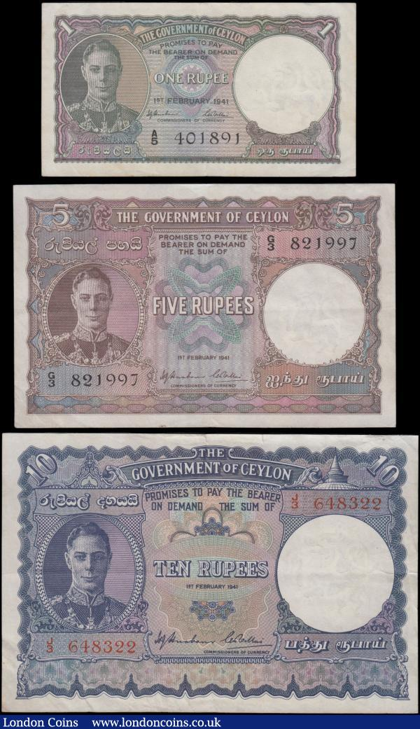 Ceylon Government (3), 10 Rupees dated 1st February 1941 series J/3 648322, (Pick33a) small edge tear to top border, one set of staple holes at left, about VF, 5 Rupees dated 1st February 1941 series G/3 821997 (Pick32) VF, 1 Rupee dated 1st February 1941 series A/5 401891, (Pick30) one set of staple holes at left, about VF, all with portrait King George VI at left : World Banknotes : Auction 163 : Lot 1413