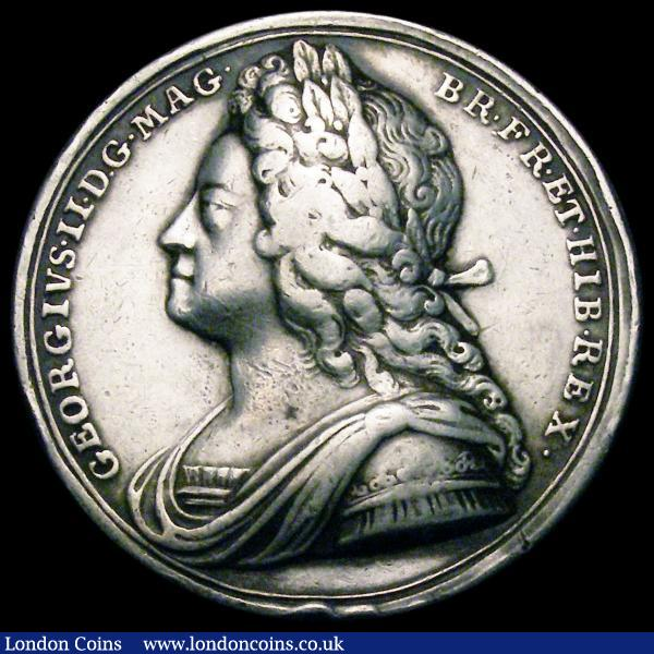 Coronation of George II 1727 34mm diameter in silver by J.Croker Eimer 510 the official coronation issue Obverse Bust left Laureate, armoured and draped, GEORGIVS. II. D.G. MAG. BR. FR. ET. HIB. REX. Reverse the King enthroned right, is crowned by Britannia, VOLENTES.PER.POPULOS.Exergue: CORON.XI.OCTOB.MDCCXXVII Fine with some edge knocks : Medals : Auction 163 : Lot 53