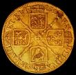 London Coins : A164 : Lot 1000 : Guinea 1715 S.3630 VG/NF the reverse with a flan flaw on the R of BRVN