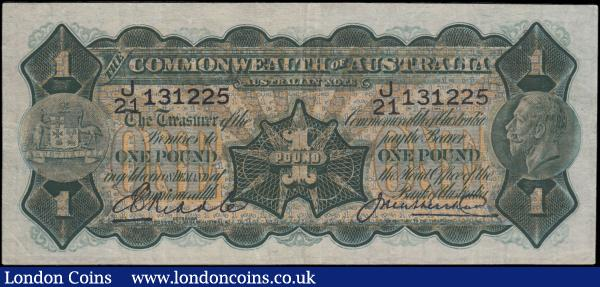 "Australia Commonwealth 1 Dollar Pick 16c ND (1926-1932) signatures Riddle & Heathershaw serial number J/21 131225 and the note in dark olive-green on multicolour underprint featuring Portrait King George V at right, Australia's Coat of Arms at left ant the left signature with title ""GOVERNOR / COMMONWEALTH BANK OF AUSTRALIA"". Without imprint. And reverse depicting an illustration of Captain Cook's landing at Botany Bay on 29th April 1770 with his ship HMS Endeavour on the land mass of Australia after an extensive navigation of New Zealand. VF pressed and an Exceptionally Rare note : World Banknotes : Auction 166 : Lot 110"