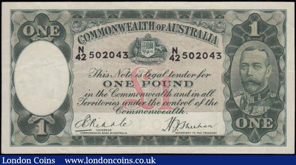 "Australia Commonwealth Bank 1 Dollar Pick 22a ND 1933-1938 serial number N/42 502043 signatures Riddle & Sheehan and the note in dark green on multicolour underprint featuring Portrait King George V at right and Australia's Coat of Arms at upper centre on obverse and Allegorical Pastoral figures shepherds with sheep on reverse and large value at centre left on reverse. Watermark: Edward (VIII), Prince of Wales and ""ONE POUND"" at lower centre panel. GVF and scarce : World Banknotes : Auction 166 : Lot 116"