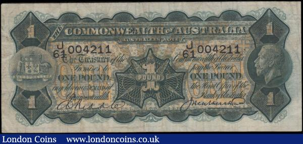 "Australia Commonwealth Bank King George V 1 Pound Pick 16c 1926 - 1932 signature title at left Governor / Commonwealth Bank of Australia and signed Riddle & Heathershaw serial number J/64 004211. The note in dark olive-green on multicolour underprint featuring portrait of King George V at right and Coat of Arms at left on obverse and the reverse depicting Captain Cook's landing at Botany Bay on 29 April 1770 after his extensive navigation of New Zealand with his ship ""HMS Endeavour"".  About VF and a very Scarce issue : World Banknotes : Auction 166 : Lot 120"