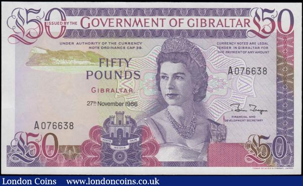Gibraltar Government 50 Pounds Pick 24 dated 27th November 1986 serial number A 076638, fresh and crisp about UNC - UNC, an impressive and eye-pleasing large note and the Scarce highest denomination for the series. Purple on multi-coloured underprint featuring H.M. Queen Elizabeth II, Gibraltar's Coat of Arms and sea view with Rock of Gibraltar on obverse. The reverse illustrating an aerial view of Gibraltar with Rock of Gibraltar, the impressive 426 metres high limestone ridge and Gibraltar's most recognized landmark. Thomas De La Rue printing and watermarked with a bust of H.M. the Queen facing right.  : World Banknotes : Auction 168 : Lot 191