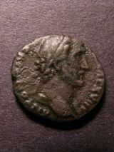 London Coins : A125 : Lot 633 : Antoninus Pius copper As, R. Britannia seated left on rock. S.666. Good fine.