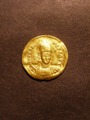London Coins : A129 : Lot 1022 : Roman Gold Solidus Honorius (393-423 AD)  Obverse DN HONORIVS PF AVG helmeted and cuirassed bust fac...