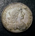 London Coins : A132 : Lot 871 : Crown 1676 ESC 51 EF the obverse with some haymarking, with a small flan flaw at 3 o'clock and w...