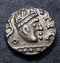 London Coins : A133 : Lot 109 : Anglo-Saxon Primary Ar Sceat.  C, 680-710.  Series A.  Obv&#59; Radiate bust r, TIC before. ...
