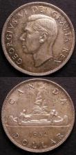 London Coins : A144 : Lot 561 : Canada Dollars (2) 1939 KM#38 Lustrous UNC, 1952 3 water lines KM#46 UNC toned