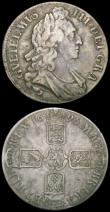 London Coins : A165 : Lot 2550 : Crowns (2) 1688 ESC 80, Bull 748 Fine, the obverse with some scratches under old toning, 1696 ESC 94...