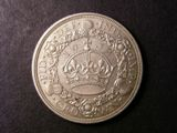 London Coins : A134 : Lot 1883 : Crown 1933 ESC 373 EF with a small dark spot in the wreath
