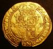 London Coins : A143 : Lot 1554 : Unite James I Second Coinage, Fourth Bust S.2619 mintmark Cinquefoil Good Fine with an edge cut to t...
