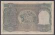 London Coins : A155 : Lot 1880 : India 100 rupees KGVI issued 1943 series A/77 455113, Calcutta branch, signed Deshmukh, Pick20e, 2 s...