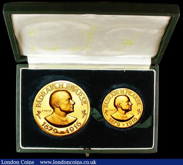 Ireland - Republic Padraig H. Pearse 1879-1916 boxed commemorative medal two piece set (50mm and 36mm diameters) in 22 carat gold by Paul Vincze 1966, 1916 - 1966 50 years anniversary of Easter Rising PADRAIG H PEARCE 1879 - 1916 surrounding right facing portrait obverse WE PLEDGE OUR LIVES AND THE LIVES OF OUR COMRADES IN ARMS TO THE CUASE OF ITS FREEDOM OF ITS WELFARE AND OF ITS EXALTATION AMONG THE NATIONS reverse above two figures holding flags, total weight 189 grams so over 5 1/2 ounces pure gold content so the gold value alone in the region of £6,000 but rare as medals especially this large double gold issue, we were unable to find any previous sales results for this rare two coin set. Choice Unc in the two coin green display box with 1916 - 1966 in gold on the lid.   Paul Vincze also designed coins and is responsible for designs on coins from The Channel Islands, Rhodesia and Nyasaland, Nigeria and more : Medals : Auction 155 : Lot 2106