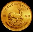 London Coins : A163 : Lot 2147 : South Africa Krugerrand 1980 KM#73 UNC or near so, lightly toning, with some small edge nicks