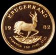 London Coins : A163 : Lot 2149 : South Africa Krugerrand 1982 Proof KM#73 nFDC retaining much original mint brilliance, in a South Af...