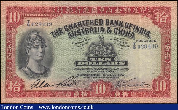 Hong Kong The Chartered Bank of India, Australia & China 10 Dollars Pick 55a (Mars Illustrated Catalogue of Hong Kong Currency S12, KNB34a) and a very FIRST date for this type 1st July 1931 with 1 printed & 1 hand signed signature serial number T/G 029439, original GVF - about EF and an Exceptionally Rare note especially in this high grade for this very first date of issue. The note in black and red on light red and green underprint featuring a portrait of a helmeted warrior at left and the Royal Coat of Arms at centre on obverse. The reverse with an illustration of rice field farmers at work and pagoda building. Printed by Waterlow & Sons Limited London and watermarked with a helmeted warrior same as on obverse facing left. A very tough to acquire seldom offered example of this early first date for this type and perhaps one of the very few high-grade examples seen if not the highest. According to our research no examples of this date have been offered in grades above VF in fact the PMG Population report indicates only 32 recorded examples of this type at the time of writing with none above Choice VF 35 with the majority between VF20 and VF30, the only 1 highest graded being Choice VF35 EPQ. According to the story this note had been hiding away in a big and old late 1800's book in the possession and gifted to the owner's family from the time of their grandfather and his sister (grandmother). They were based in Chatham and the grandfather was working for the Navy at the time, serving regular tours to China, Hong Kong and general Asia and the grandfather's sister lived in Hong Kong with her husband who unfortunately passed away in one of Hong Kong's major earthquakes after which she returned to the UK. It is uncertain which of the two was the book containing this note gifted to and who had brought it back, but it is certain that this note is a fabulous and Rare find : World Banknotes : Auction 169 : Lot 195