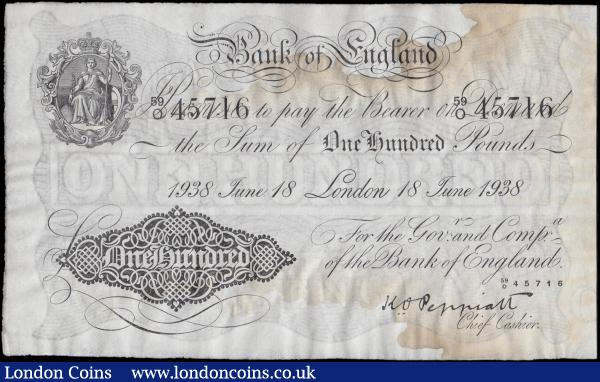 One Hundred Pounds Peppiatt First Period White Note B245 Unthreaded issue dated 18th June 1938 serial number 59/O 45716 LONDON branch issue, GVF - about EF damped liquid staining otherwise very well preserved and an Exceptionally Rare high denomination genuine early Pre-war Bank of England issue.  These high denomination Britannia medallion White notes were rarely seen by the public, if at all, and they were mostly used for inner bank transactions at the time. Highly sought after and rarely seen in modern days, especially in a well preserved state, these notes have a very limited number of survivors left and are a fabulous addition to any fine British collection. : English Banknotes : Auction 170 : Lot 52
