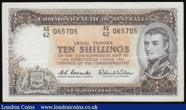 "Australia Reserve Bank 10 Shillings Pick 33a (McD 25, Rks. 17) ND 1961-65 signatures Coombs & Wilson serial number AG/62 065705, presentable good Fine. The note in dark brown on orange and green underprint featuring Mathew Flinders portrait and Australia's Coat of Arms on obverse. The reverse illustrating the Parliament house, Canberra. Watermarked James Cook and denomination in wording (""HALF"") twice at lower centre. : World Banknotes : Auction 171 : Lot 84"