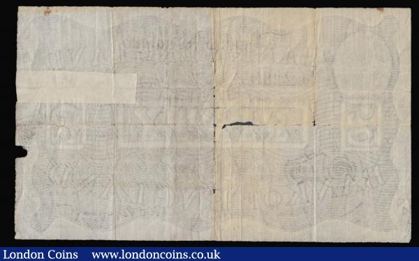 Fifty pounds Peppiatt white B244 dated 15th April 1935 series 53/N 62280 VG many folds and some holes, taped in one place on the reverse : English Banknotes : Auction 172 : Lot 22